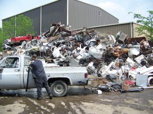 employees helping remove scrap metal