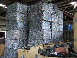 Volunteer Recycling and Salvage aluminum cans stacked up in in compressed squares